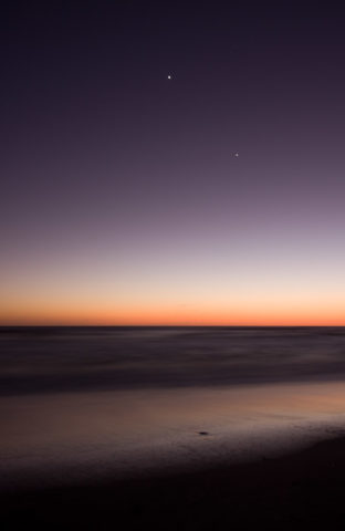 Jupiter and Venus are seen setting in the night's sky just after sunset.