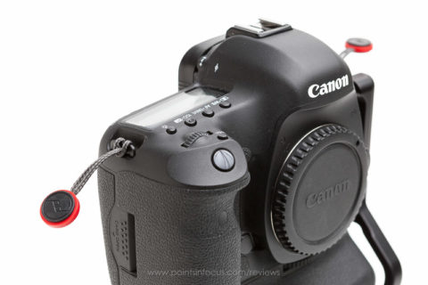 With the strap disconnected, all that's left on the camera is two small tails with the attachment disks. Unlike some other systems, they're not long enough to fall in the mirror box or interfere with changing lenses.