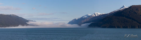 Morning fog fills the Glastineau Channel on approach to Juneau.